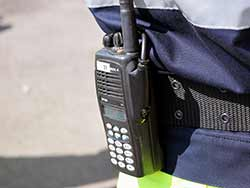 Photo of a walkie-talkie on the belt of an emergency services worker